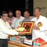 Sandeep Goel Presenting Shri Shante Prasad Goel Award with Minister Harish Rawat to Dr J.p Sharme ( Iari Pusa)at Ndri Karnal