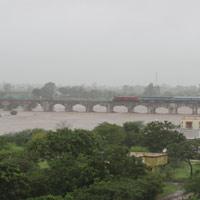 Train River Bridge During Monsoons